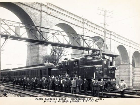 The first electric train arrives at High Bridge