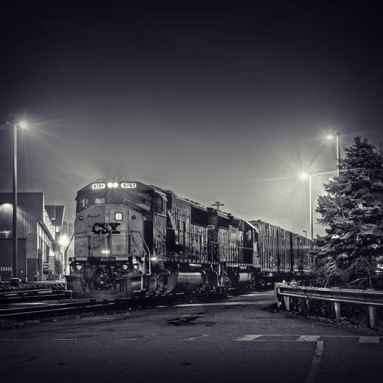 The evening CSX garbage train waits at Highbridge after coming on to the Hudson Line from the Oak Point Link