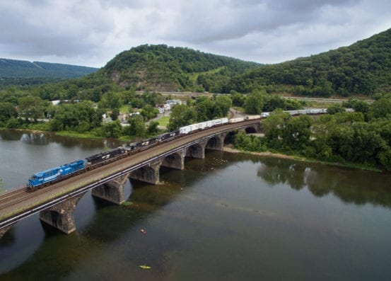 Another cloudy day as the Conrail heritage unit passes over the Rockville Bridge