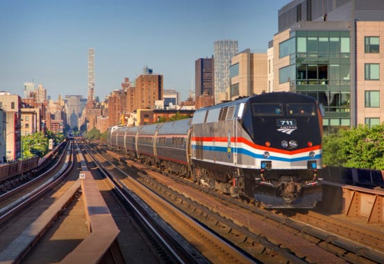 The first revenue train heads into Grand Central, from Harlem 125th Street