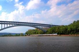 Passing by Spuyten Duyvil and under the Henry Hudson Bridge