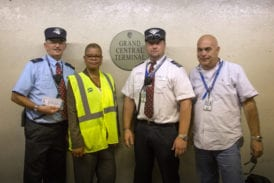 The crew of Train 235 pose next to the Grand Central platform sign