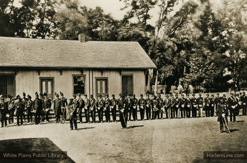 A group of Civil War soldiers stand in front of the first White Plains depot in 1865