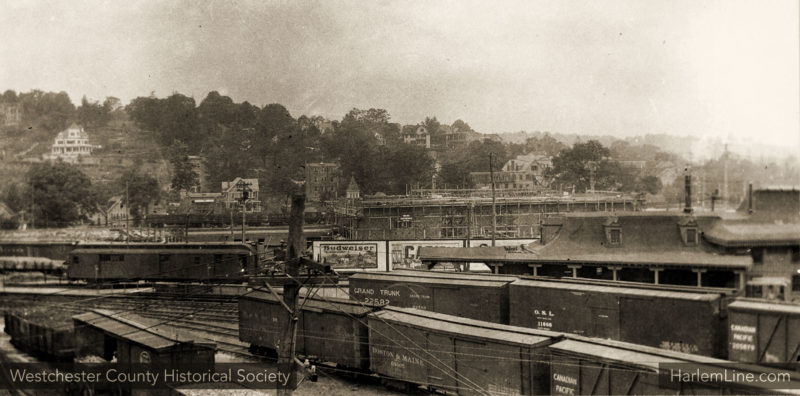 The old station with the new one in construction behind, circa 1913.